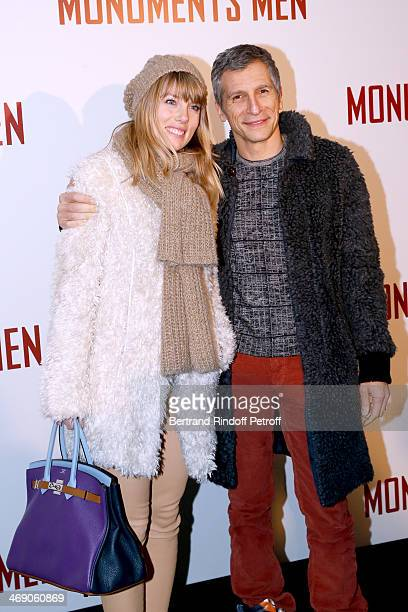 Nagui with his wife actress Melanie Page attend the 'Monuments Men' Premiere at Cinema UGC Normandie on February 12 2014 in Paris France