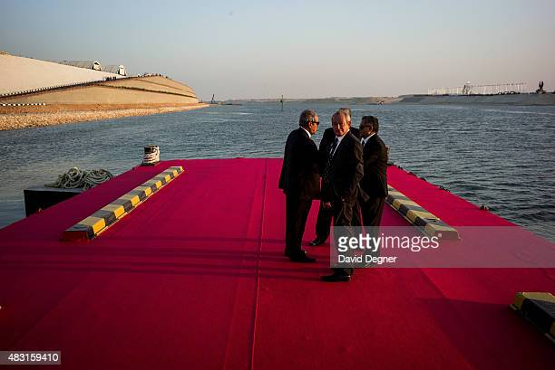 Naguib Sawiris and other businessmen wait for their boat after the opening ceremony of the new Suez Canal expansion including a new 35km channel on...