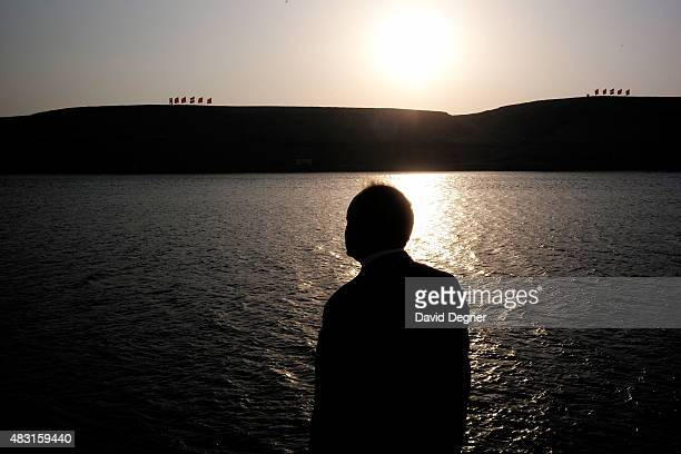 Naguib Sawiris one of the richest men in Egypt waits for their boat after the opening ceremony of the new Suez Canal expansion including a new 35km...