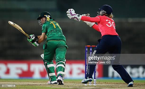 Nahida Khan of Pakistan hits the ball toward sthe bounadry as Sarah Taylor of England looks on during the Women's ICC World Twenty20 India 2016 match...