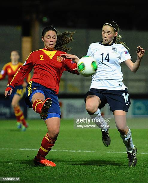 Nahikari Garcia of Spain tackles Lucy Porter of England during the UEFA European Women's Under17 Championship Semi Final between Spain and England at...
