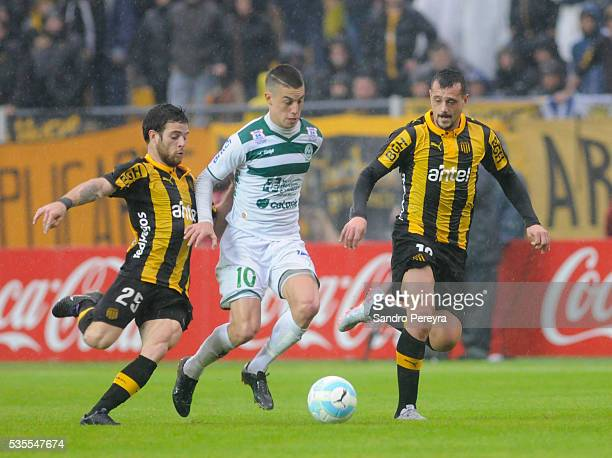 Nahitan Nandez and Matias Aguirregaray of Penarol fight for the ball with Nicolas Milesi of Plaza Colonia during a match between Penarol and Plaza...