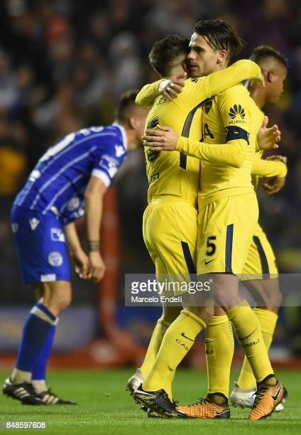 Nahitan Nandez of Boca Juniors celebrates with teammate Fernando Gago after scoring the fourth goal of his team during a match between Boca Juniors...