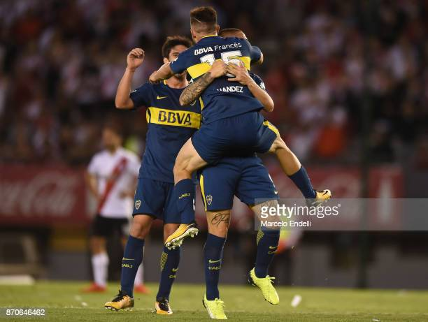 Nahitan Nandez of Boca Juniors celebrates with teammates after scoring the second goal of his team during a match between River Plate and Boca...
