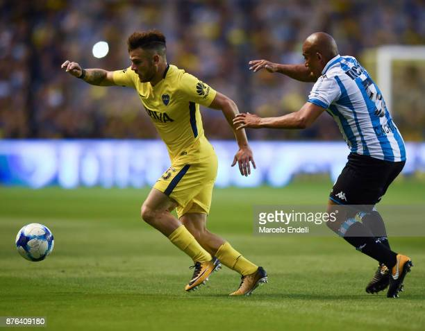 Nahitan Nandez of Boca Juniors fights for ball with Arevalo Rios of Racing Club during a match between Boca Juniors and Racing Club as part of the...