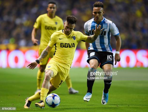 Nahitan Nandez of Boca Juniors fights for ball with Lautaro Martinez of Racing Club during a match between Boca Juniors and Racing Club as part of...