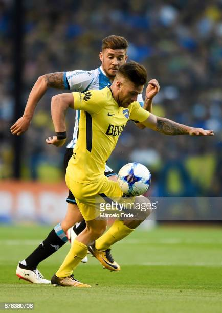 Nahitan Nandez of Boca Juniors fights for ball with Miguel Barbieri of Racing Club during a match between Boca Juniors and Racing Club as part of the...