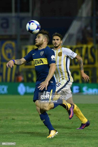 Nahitan Nandez of Boca Juniors fights for the ball with Maximiliano Fernandez of Rosario Central during a match between Rosario Central and Boca...