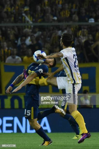 Nahitan Nandez of Boca Juniors fights for the ball with Maximiliano Gonzalez of Rosario Central during a match between Rosario Central and Boca...
