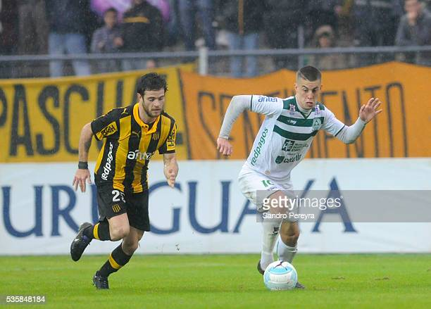 Nahitan Nandez of Penarol and Nicolas Milesi of Plaza Colonia fight for the ball during a match between Penarol and Plaza Colonia as part of...