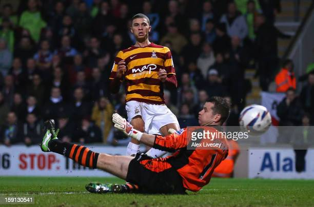 Nahki Wells of Bradford City scores the opening goal past Shay Given of Aston Villa during the Capital One Cup SemiFinal 1st Leg match between...