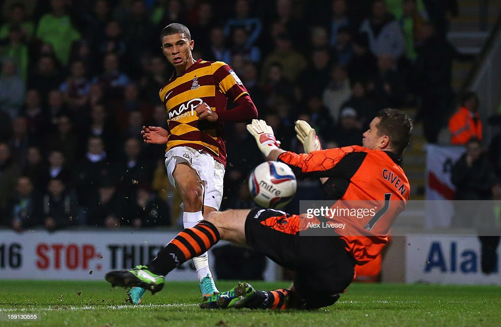 Nahki Wells of Bradford City scores the opening goal past Shay Given of Aston Villa during the Capital One Cup Semi-Final 1st Leg match between Bradford City and Aston Villa at Coral Windows Stadium, Valley Parade on January 8, 2013 in Bradford, England.