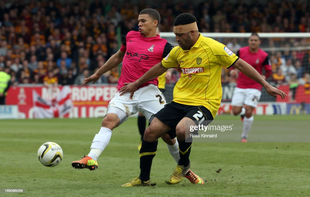 Nahki Wells of Bradford is challenged bu Marcus Holness of Burton during the npower League Two Play Off Semi Final: Second Leg match between Burton Albion and Bradford City at Pirelli Stadium on May 5, 2013 in Burton-upon-Trent, England.