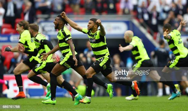 Nahki Wells of Huddersfield Town celebrates promotion to the Premier League as his team win the penalty shoot out after the Sky Bet Championship play...