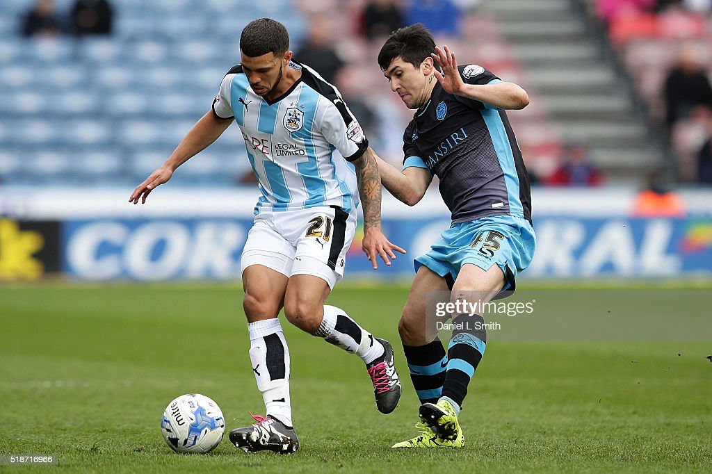 Nahki Wells of Huddersfield Town FC and Fernando Forestieri of Sheffield Wednesday FC compete for the ball during the Sky Bet Championship match between Huddersfield Town and Sheffield Wednesday at Galpharm Stadium on April 2, 2016 in Huddersfield, United Kingdom.