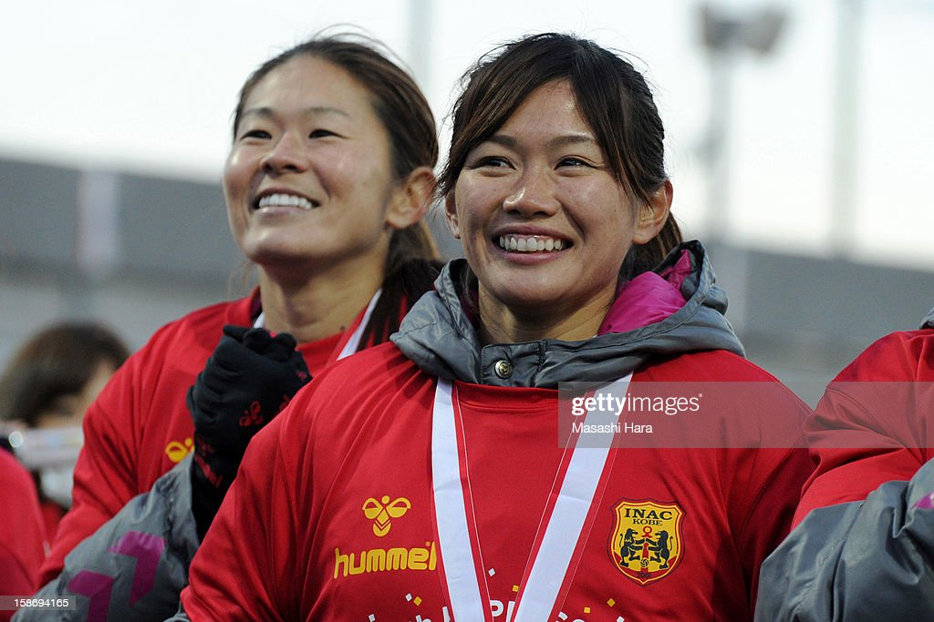 Nahomi Kawasumi #9 (R) and Homare Sawa #8 of INAC Kobe Leonessa look on during the 34th Empress's Cup All Japan Women's Football Tournament final match between INAC Kobe Leonessa and JEF United Chiba Ladies at Nack 5 Stadium Omiya on December 24, 2012 in Saitama, Japan.
