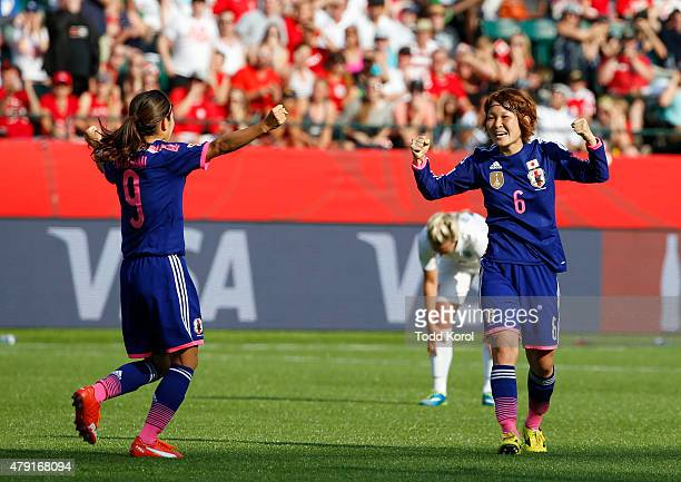 Nahomi Kawasumi and Mizuho Sakaguchi of Japan celebrate after Laura Bassett of England scored on her own team in the final minutes of the game during...