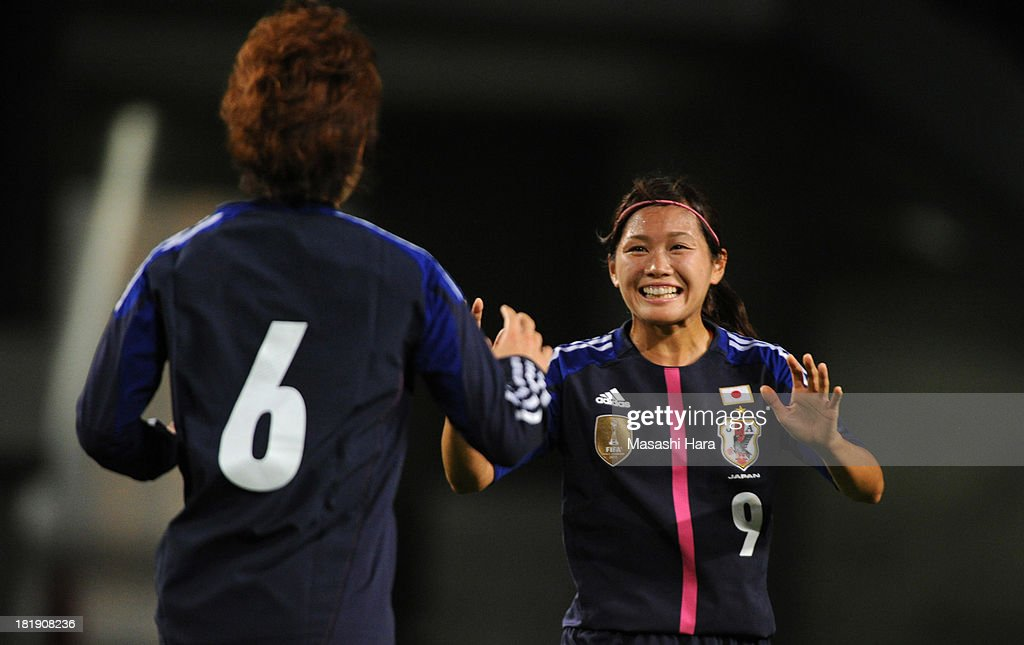 Nahomi Kawasumi #9 (R) and Mizuho Sakaguchi #6 of Japan celebrate the second goal during the Women's international friendly match between Japan and Nigeria at Fukuda Denshi Arena on September 26, 2013 in Chiba, Japan.