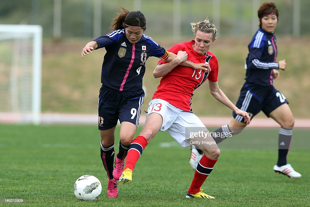 Nahomi Kawasumi MF of Japan challenges Gry Tofte Ims MF of Norway during the Algarve Cup match between Japan and Norway at the Complexo Desportivo Belavista on March 6, 2013 in Parchal, Portugal.