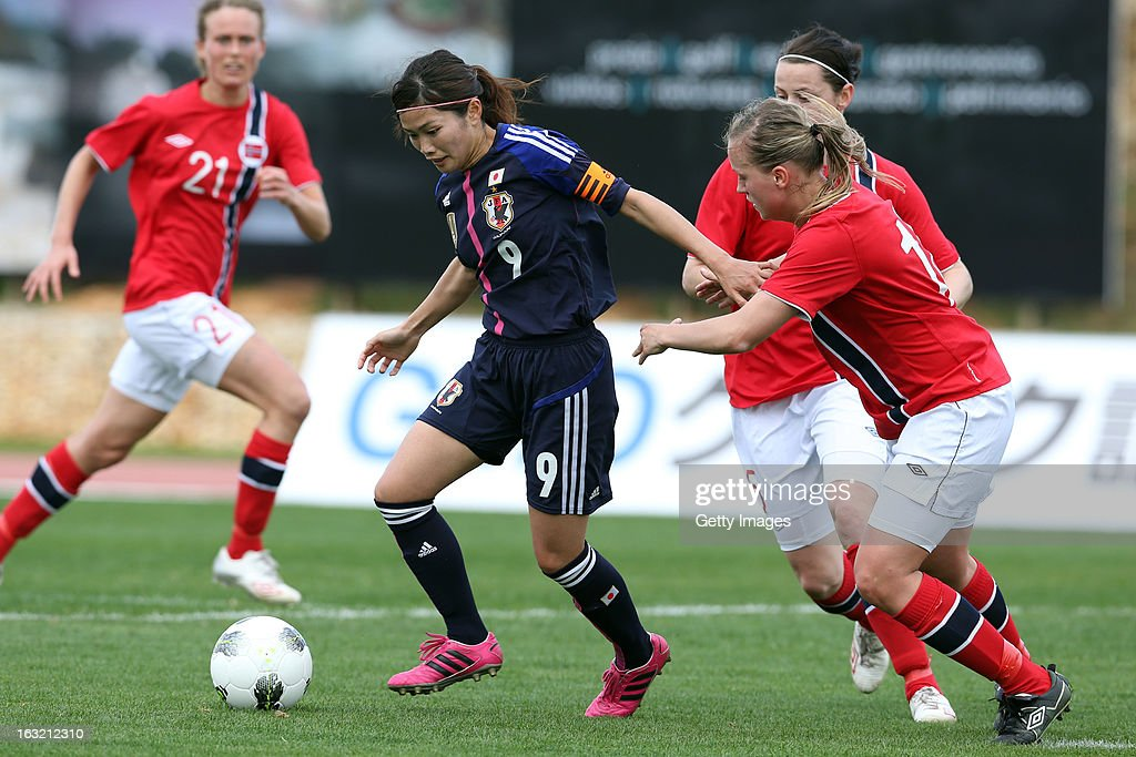 Nahomi Kawasumi MF of Japan challenges Nora Holstad Berge DF of Norway during the Algarve Cup match between Japan and Norway at the Complexo Desportivo Belavista on March 6, 2013 in Parchal, Portugal.