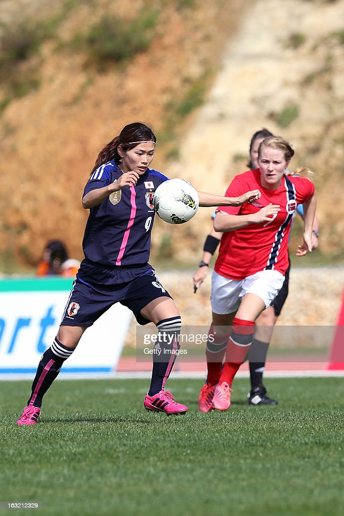 Nahomi Kawasumi MF of Japan challenges Norway opponents during the Algarve Cup match between Japan and Norway at the Complexo Desportivo Belavista on March 6, 2013 in Parchal, Portugal.