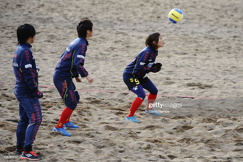 Nahomi Kawasumi of INAC Kobe Leonessa Ladies (R) heads the ball during a training session at the Club Natacion Barcelona sport complex in La Barceloneta beach on February 5, 2012 in Barcelona, Spain.