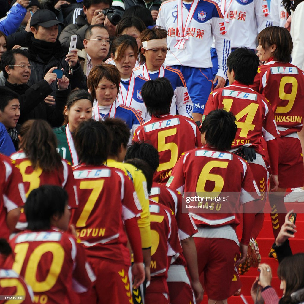 Nahomi Kawasumi #9 of INAC Kobe Leonessa (R) talk with a freind of her's childhood Megumi Kamionobe #10 of Albirex Nigata Ladies (L,bandage) before an awarding ceremony during the All Japan Women's Soccer Championship Final match between Albirex Niigata Ladies and INAC Kobe Leonessa at the National Stadium on January 1, 2012 in Tokyo, Japan.