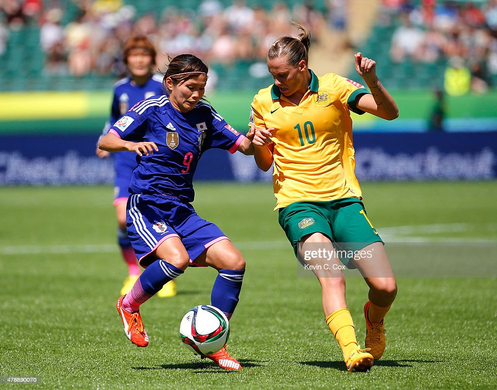 Nahomi Kawasumi of Japan against Emily Van Egmond of Australia during the FIFA Women's World Cup Canada 2015 Quarter Final match between Australia...