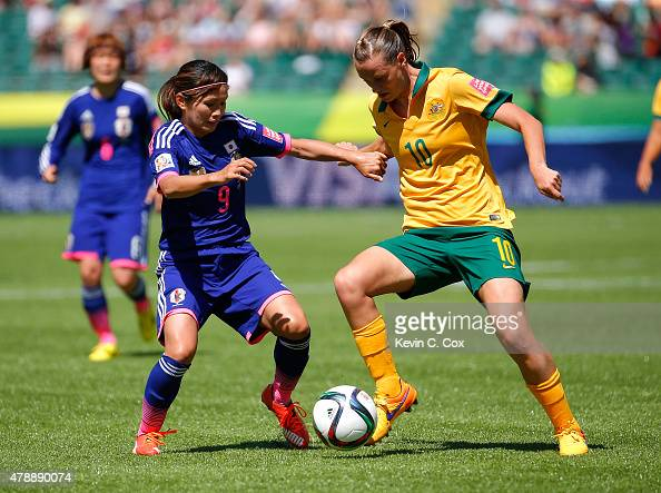 Nahomi Kawasumi of Japan against Emily Van Egmond of Australia during the FIFA Women's World Cup Canada 2015 Quarter Final match between Australia...