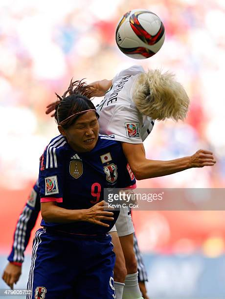 Nahomi Kawasumi of Japan and Megan Rapinoe of the United States of America go up for a header in the FIFA Women's World Cup Canada 2015 Final at BC...