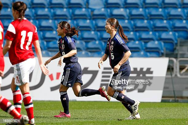 Nahomi Kawasumi of Japan celebrates her goal followed by Aya Sameshima of Japan during the Algarve Cup 2013 match between Denmark and Japan at the...