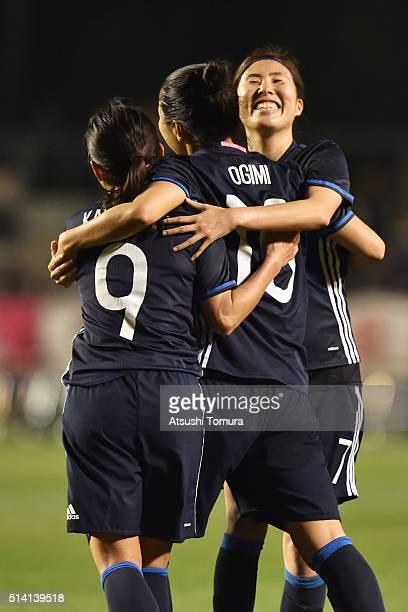 Nahomi Kawasumi of Japan celebrates scoring her team's third goal with her team mate Yuki Ogimi and Yuri Kawamura during the AFC Women's Olympic...