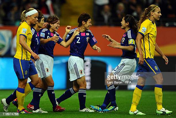 Nahomi Kawasumi of Japan celebrates with team mates after scoring his teams first goal during the FIFA Women's World Cup Semi Final match between...
