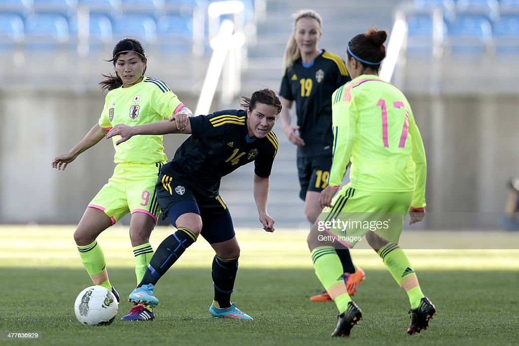 Nahomi Kawasumi of Japan challenges Hanna Folkesson of Sweden during the Algarve Cup 2014 match between Japan and Sweden on March 10, 2014 in Loule, Portugal.