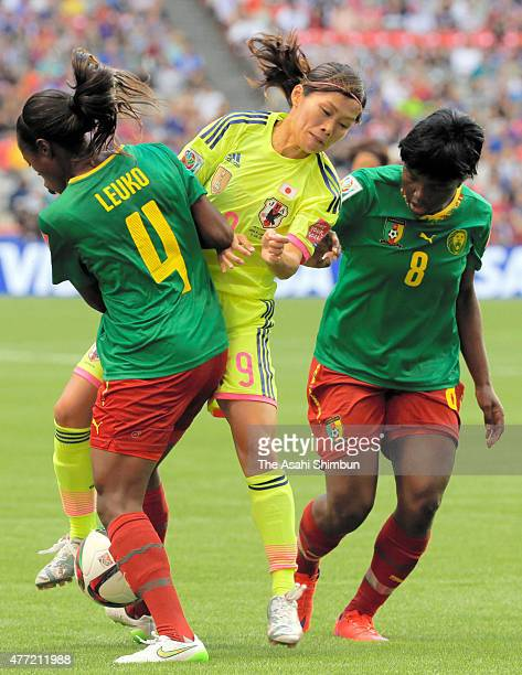 Nahomi Kawasumi of Japan competes for the ball against Yvonne Leuko and Raissa Feudjio of Cameroon during the FIFA Women's World Cup 2015 Group C...