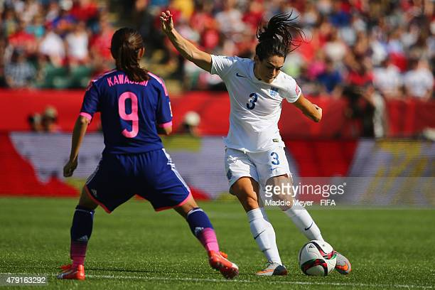 Nahomi Kawasumi of Japan defends a shot by Claire Rafferty of England during the FIFA Women's World Cup Canada 2015 semi final match between England...
