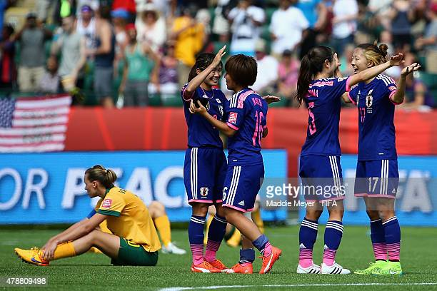 Nahomi Kawasumi of Japan Mana Iwabuchi Aya Sameshima and Yuki Ogimi celebrate their teams 10 win over Australia in the FIFA Women's World Cup Canada...