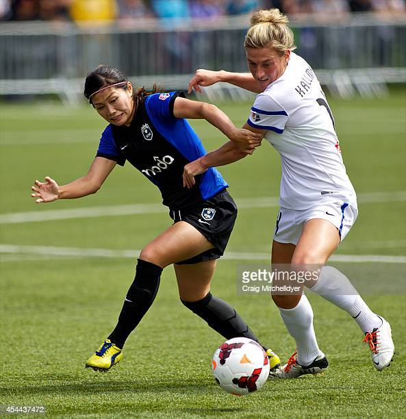 Nahomi Kawasumi of Seattle Reign FC controls the ball against Kassey Kallman of FC Kansas City in the first half of the National Women's Soccer...