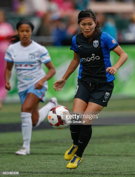 Nahomi Kawasumi of the Seattle Reign FC controls the ball against Lori Chalupny of the Chicago Red Stars at Moda Pitch at Memorial Stadium on July 20...