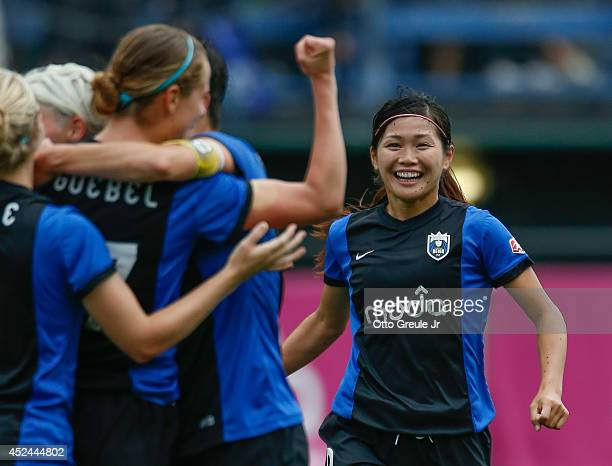 Nahomi Kawasumi of the Seattle Reign FC joins the celebration after Beverly Goebel scored a goal against the Chicago Red Stars on Moda Pitch at...