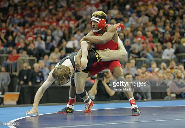 Nahshon Garrett of the Cornell Big Red wrestles Cory Clark of the Iowa Hawkeyes during the finals of the NCAA Wrestling Championships on March 19...