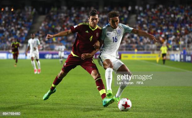 Nahuel Ferraresi of Venezuela and Dominic CalvertLewin of England battle for the ball during the FIFA U20 World Cup Korea Republic 2017 Final between...