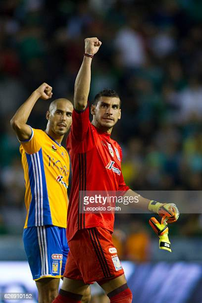 Nahuel Guzman and Guido Pizarro of Tigres celebrate the victory after the semifinals first leg match between Leon and Tigres UANL as part of the...