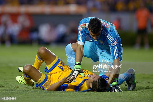 Nahuel Guzman goalkeeper of Tigres assists teammate Hugo Ayala during a first leg final match between Tigres UANL and River Plate as part of Copa...