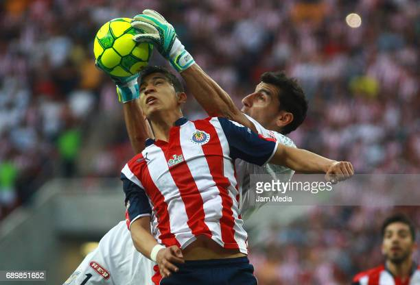 Nahuel Guzman goalkeeper of Tigres catches the ball over Angel Zaldivar of Chivas during the Final second leg match between Chivas and Tigres UANL as...