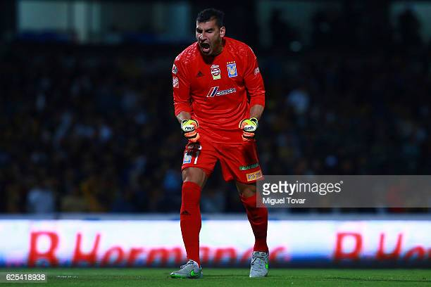 Nahuel Guzman goalkeeper of Tigres celebrates after his team scored during the quarter finals first leg match between Pumas UNAM and Tigres UANL as...