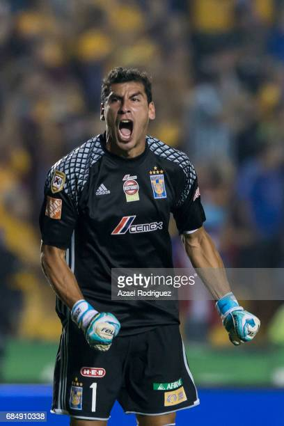 Nahuel Guzman goalkeeper of Tigres reacts after teammate Javier Aquino scored his team's second goal during the semi finals first leg match between...