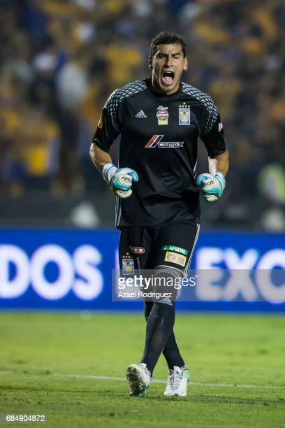 Nahuel Guzman goalkeeper of Tigres reacts after teammate Lucas Zelarayan scored his team's first goal during the semi finals first leg match between...