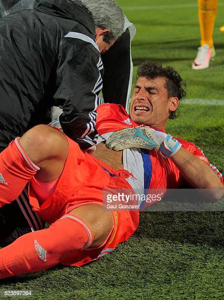 Nahuel Guzman goalkeeper of Tigres receives medical assistance during the 15th round match between Santos Laguna and Tigres UANL as part of the...
