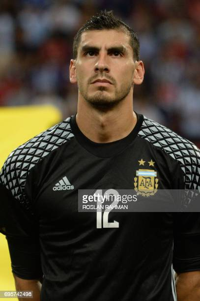 Nahuel Guzman of Argentina poses before the start of their international friendly football match against Singapore at the National Stadium in...